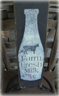 """Rustic """"Farm Fresh Milk """" hand painted barn wood sign. Country, Cabin, Farmhouse decor. Milk bottle, Cow, Black, White, Brown, Red. on Etsy, $29.99"""