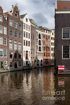 Amsterdam in Holland, Netherlands. Canal and historic houses in the Old City.