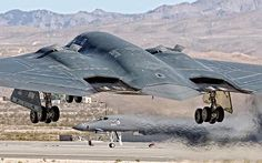 A USAF Northrop B-2 Spirit bomber touches down on the runway.