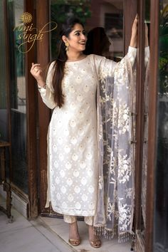 4153bfa586b White cotton chanderi kurta with booties paired with a banarsi silk brocade cigarette  pants and net