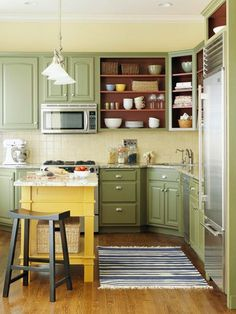 Green kitchen cabinets. No doors on some, paint interior brown.