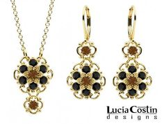 Jewelry Set: Pendant and Earrings by Lucia Costin with Twisted Lines, Garnished with Brown and Black Swarovski Crystals; 14K Yellow Gold Plated over .925 Sterling Silver; Handmade in USA Lucia Costin. $118.00. Adorned with brown and black Swarovski crystals. Style takes wings in this lovely jewelry set that have a graceful flower shape. Jewelry set by Lucia Costin. Floral design accompanied by cute details. Handmade in USA unique jewelry set