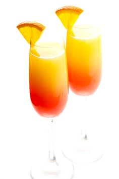 Tequila sunrise cocktails meet mimosas in this gorgeous, bubbly recipe! Feel free to use traditional tequila, or you can try mezcal for a smoky kick!