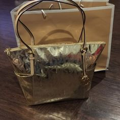 """New Michael Kors Tote New with tags 100% authentic Michael Kors pale gold tote. 12"""" L x 11"""" Hx 5"""" W Michael Kors Bags Totes"""