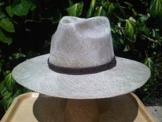Summer men's hat, handmade of straw with a leather ribbon