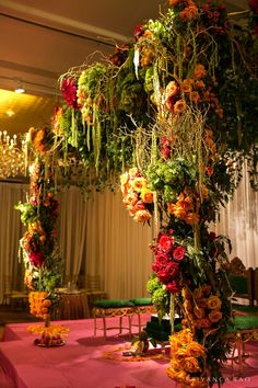 Multicolored flower mandap   Colorful fusion wedding filled with thousands of yellow, orange, and purple flowers: http://www.xaazablog.com/candy-colored-fusion-wedding-ritu-and-greg/   Photography: Priyanca Rao Photography   Decor: Design House Decor   #weddingdecor #indianwedding #indianweddingdecor