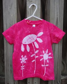 Fuchsia toddler tee with hand-drawn batik flower garden. Made in the USA! By peacebabybatiks on Etsy