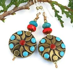 These fun Southwest style handmade earrings are a lovely combination of antiqued brass flower beads with faux turquoise and coral, faceted red Czech glass, faceted genuine turquoise rondelles, bronze by @shadowdog
