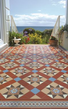 Victorian Floor Tiles - the Blenheim pattern with a Telford border. Elegant with splashes of eye catching accent blue works well in this setting. And what a view!
