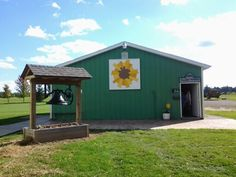Barn quilt block on Mayville Historic Museum, Mayville Michigan.  A part of the Thumb Quilt Trail, the Modern Dresdon designed by quilting artist Nikki Maroon, looks beautiful as you are touring the thumb area.  See more pics on facebook at thumb quilt trail