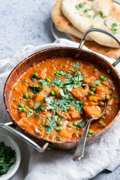 Aloo matar is a delicious Indian dish with potatoes and peas in a curried tomato sauce. It's super easy to make and the perfect comfort food! It's vegan and naturally gluten free. #indian #veganfood #veganrecipe #veganindian #curry #vegancurry