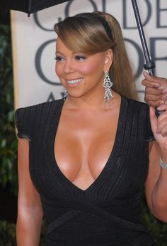Mariah Carey huge cleavage in a plunging dress