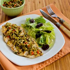 Pan-Grilled Chicken with Green Olive, Caper, and Lemon Relish:  3/4 c green olives with pimientos,  2 T blanched almonds,  1 T capers,  1-2 tsp. lemon zest,  1 tsp. fresh thyme (or 1/2 tsp. dried thyme) 1/2 tsp. minced garlic (or more) 3 T olive oil,  3 or 4 boneless, skinless chicken breasts,   1-2 tsp. Roast Chicken Seasoning Rub