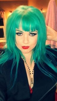 Long hair with layers and fringe made a beautiful turquoise shade by using Manic Panic Atomic Turquoise.