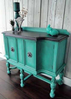 Modern Vintage​ of Hartville, OH refinished this buffet with General Finishes Patina Green Milk Paint accented with Winter White Glaze Effects. The top was stained with Java Gel Stain. Love the bright new look!
