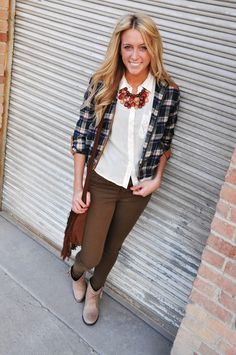 Dazzle friends by your ability to rock plaid with this plaid jacket $28.50 outfit, complete with a white blouse top $28.50, chocolate colored jeggings $54.50, and tan booties $48.50