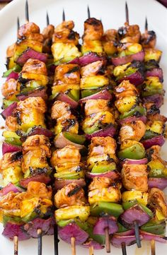 These are incredibly DELICIOUS! My husband and I loved them! Perfect for a summer meal. Ingredients 1/3 cup ketchup 1/3 cup packed dark brown sugar 1/3 cup low-sodium soy sauce 1/4 cup pineapple juice 4 Tbsp olive oil, divided, plus more for brushing grill 1 1/2 Tbsp rice vinegar 4 garlic cloves, minced (4 tsp) 1 Tbsp minced ginger 1/2 tsp sesame oil Salt and freshly ground black pepper 1 3/4 lb boneless, skinless chicken breast, chopped into 1 1/4-inch cubes 3 cups (heaping) fresh cubed…