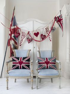 Show some love with lad and lassie seating. This vignette sings out with English pride from top to bottom. The faded flag and worn fabric banner drape across the classy wardrobe, uniting for a vivid splash of red, white and blue in this modern-vintage combination.