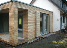 """Cladding made of tongue and groove planks in """"rhombus-slat-look"""" facade . Wooden Cladding, Wooden Facade, Danish House, Glass Porch, Building Extension, House Extensions, Home Additions, Cabin Homes, Modern Exterior"""