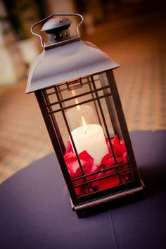 This charming centerpiece is a great option for the DIY bride! This rustic lantern gets a pop of color from the red rose petals. Fresh and freeze dried rose petals are available in a variety of colors year-round at GrowersBox.com.
