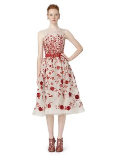 I've had my eye on this Oscar de la Renta since I first laid on eyes on it.  That's embroidered raffia!