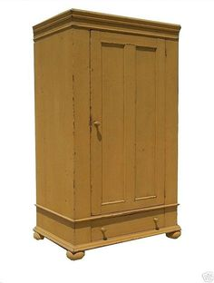Primitive wardrobe armoire tv cupboard cabinet entertainment center painted country reproduction furniture. $1,550.00, via Etsy.