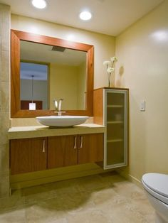floating vanity and framed mirror, clean and elegant. Seems to mix mid century and contemporary