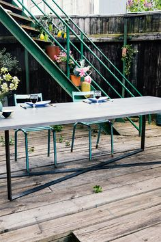 Grey concrete table top on iron table base. Design by Storm&Müller