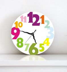 Easter spring kids children Wall clock bright rainbow typography large numbers round wall clock kids nursery wall art gift under 50. $49.00, via Etsy.