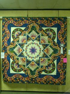 Glacier Star designed by Quiltworx.com, made by Rayni Lambert, quilted by Marlene Oddie of KISSed Quilts.  This Glacier Star with extended borders took 3rd place People's Choice, Walla Walla Valley Quilt Festival 2013.
