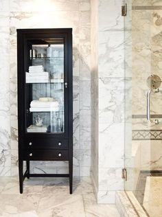 Designed as a cabinet for displaying china or keepsakes, this glass-paneled rosewood-veneer piece includes three adjustable shelves for holding towels and sundries. Bathroom Cabinetry, Cabinets, Bath Storage, Bathroom Inspiration, Bathroom Ideas, Bathroom Mirrors, Bathroom Organisation, Organization, White Rooms