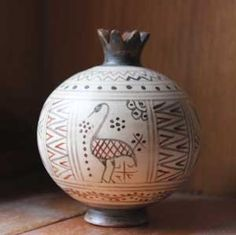Copy of a Greek terracotta pomegranate of the Geometric period (750 B.C.). Ancient symbol of good luck and prosperity.