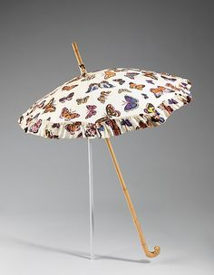 Elsa Schiaparelli (Italian, 1890–1973). Parasol, summer 1937. The Metropolitan Museum of Art, New York. Brooklyn Museum Costume Collection at The Metropolitan Museum of Art, Gift of the Brooklyn Museum, 2009; Gift of Arturo and Paul Peralta-Ramos, 1955 (2009.300.1224) | For her summer 1937 collection, Schiaparelli featured the butterfly print on parasols, silk evening dresses and her new waltz-length evening dresses.