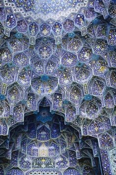 Muqarnas- a type of architectural detail. These are in the Imam Mosque in Isfahan, Iran.
