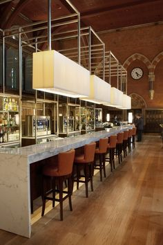 The Booking Office Bar (St. Pancras Renaissance Hotel, London). Love the repetition of long expanse of lines in the fixtures, bar, and row of chairs.