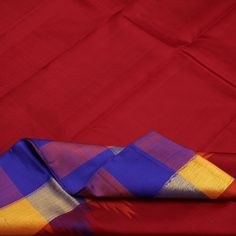 This bold Sarangi #sari will complement your colourful and vibrant personality. The luscious dark red silk body is contrasted with a wide chequered border in indigo, mango, plum and gold edged with a row of temple motifs. The indigo pallu is a study in contrast with glistening gold lines running vertical and horizontal. A plain expanse of indigo with the rich zari border makes up the blouse fabric in this lovely #Kanjivaram. An offering from Sarangi's vibrant Kanjivarams. Code 020126050.