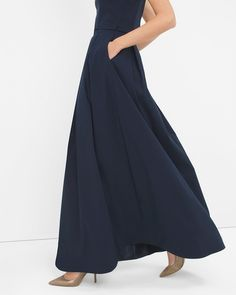 """We turned the best part of the ball gown into a pleated taffeta skirt that begs to be twirled. The full-length, full-bodied shape creates a billowy look— the perfect complement for a simple, streamlined top.  Pleated ball skirt sits at the waist  Side zip; hook-and-eye close  Fully lined with tulle hem   Upper: Polyester/nylon/spandex. Inner: Polyester. Machine wash, cold.  Approx. 47.5"""" center back length   Imported \"""