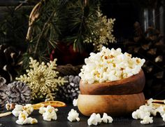 popcorn in a wooden plate on the background of Christmas by Wild Drago Shop on @creativemarket