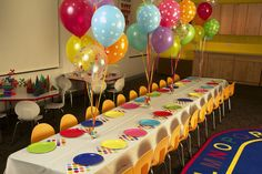 perfect kids party colorful, simple, whimsical and fun! tall balloon clusters down center of table