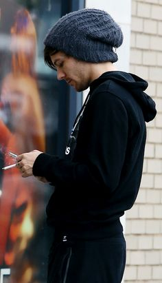 this is so hot its unhealthy i mean sweater, track pants, a beanie the cigarete and its just louis