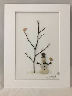 Snowman pebble art framed in shadow box.i have used genuine white sea glas… Snowman pebble art framed in shadow box.i have used genuine white sea glass for the snow . Sea Glass Crafts, Sea Glass Art, Stained Glass Art, Fused Glass, Shadow Box, Christmas Pebble Art, Christmas Rock, Xmas, Broken Glass Art