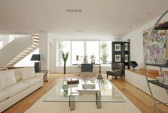 incredible-open-floor-living-room-design-with-white-sofa-glass-table-on-white-carpet-using-laminate-flooring