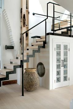 Not a truly tiny home but the concept of room under stairs, and something above it. Love how it was done here.