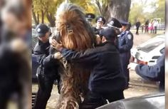 Chewbacca campaigns for Darth Vader in Ukraine, gets handcuffed by police (VIDEO)  A COM NEWS http://www.acommedianews.com Social Media: FACEBOOK https://www.facebook.com/Media-Design-NYC-911544425595388/?ref=hl https://www.facebook.com/AComNewsUSA/ https://www.facebook.com/acommedia/?ref=hl TWITTER https://twitter.com/ACOMNEWS GOOGLE+ https://plus.google.com/u/0/+ACOMNY/posts LINKEDIN https://www.linkedin.com/profile/view?id=48944586 PINTEREST https://www.pinterest.com/mediadesignnyc/