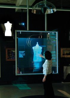 Would be cool to allow users to control a 3D projection via a rear projected semi-transparent touch display
