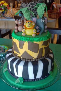 """Could use this idea with the characters from """"Madagascar""""- one of my nephews' favorite movies! Cute Cakes, Pretty Cakes, Fancy Cakes, Beautiful Cakes, Baby Boy Shower, Baby Shower Cakes, Baby Showers, Jungle Cake, Jungle Theme"""