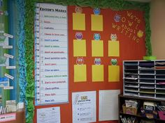 Writing bulletin board featuring different types of writing samples
