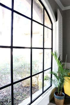 So here was my dilemma… I wanted black windows but didn't really want to pay for new windows since our home renovation cost us a [. Painting Vinyl Windows, Black Vinyl Windows, Black Windows Exterior, Black Window Trims, Metal Windows, Faux Window, Interior Windows, Black Exterior, Windows And Doors