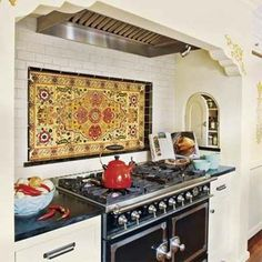 Kitchen stove alcove with Spanish tile backsplash Kitchen Stove, Kitchen Tiles, New Kitchen, Awesome Kitchen, Kitchen Appliances, Home Decor Kitchen, Home Kitchens, Decorating Kitchen, Kitchen Mantle