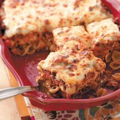 Cheesy Shell Lasagna Recipe -This zesty layered casserole is a real crowd-pleaser. It was one of our children's favorites when they were young...now our grandchildren love it! Plus, it's easier to make than traditional lasagna. —Mrs. Leo Merchant of Jackson, Mississippi